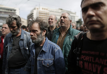 Workers from the Hellenic Skaramangas shipyard take part in a rally outside the Finance Ministry in Athens