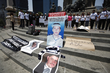Relatives and friends of victims of violence in Mexico take part in a protest at the Angel of Independence in Mexico City