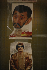Pictures from newspapers of Iran's President Mahmoud Ahmedinejad and ex Libyan leader Muammar Gadaffi are seen on the wall of a kitchen in one of the wings of the Detention Unit of the International Criminal Tribunal for the former Yugoslavia (ICTY) in Hag