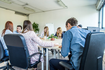 Brainstorming in a startup office