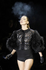 British model Kate Moss presents a creation by US designer Marc Jacobs as part of his Fall-Winter 2011/2012 women's ready-to-wear fashion collection for French fashion house Louis Vuitton during Paris Fashion Week