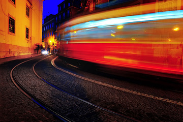 old yellow tram rides on the european city.