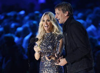 Carrie Underwood and Tony Hawk present an award at the 2012 CMT Music Awards in Nashville
