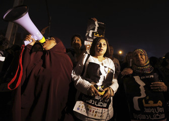 Women shout slogans during a protest against the Muslim Brotherhood and Islamic parties and in support of women rights in the constitution in front of the presidential palace in Cairo
