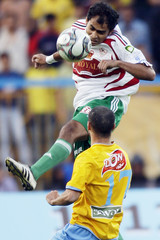 El Zamalek's Safty fights for the ball with El Ismaily's Selity during their Egyptian premier league soccer match in Ismailia