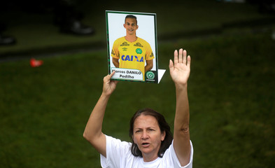 Alaide, mother of Chapecoense goalkeeper Danilo holds a picture of her son who was a victim of the plane crash in Colombia, after a ceremony to pay tribute to Chapecoense players at Arena Conda stadium in Chapeco