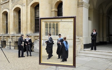 Graduates queue to have their photograph taken after a graduation ceremony at Oxford University in England