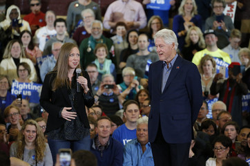 U.S. former President Bill Clinton and his daughter Chelsea speak during a campaign rally for Democratic presidential candidate Hillary Clinton in Des Moines