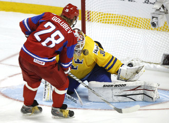 Russia's Golubev scores on Sweden's Lehner in the shootout of their semi-final game at the IIHF World Junior Hockey Championships in Buffalo