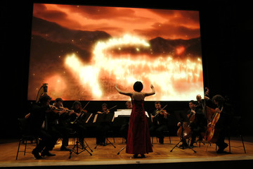 "Oshima performs during the world premiere of manga film ""Buddha 2"" at the Louvre museum in Paris"