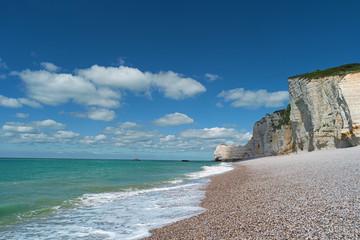 Beach, blue sea and cliffs in Etretat, France