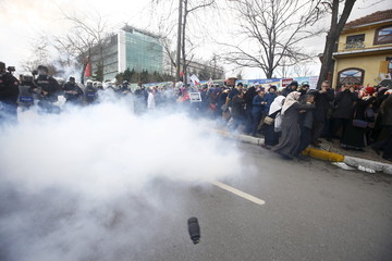 File photo of riot police using tear gas to disperse protesting employees and supporters of Zaman newspaper at the courtyard of the newspaper's office in Istanbul