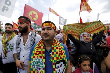 Supporters of the pro-Kurdish Peoples' Democratic Party listen to their co-chairman Selahattin Demirtas during an election rally for Turkey's June 7 parliamentary election, in Istanbul