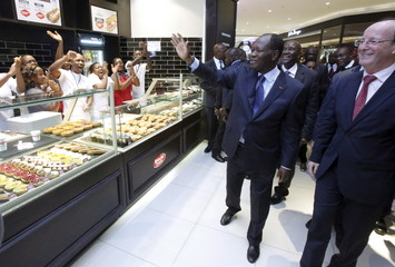Ivory Coast's President Alassane Ouattara visits the PLAYCE mall housing the French supermarket Carrefour in Abidjan