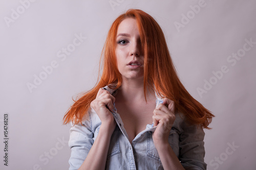 Amazing Busty Redhead Woman In Studio Photo On Gray Background Sexuality And Sensuality Attractive