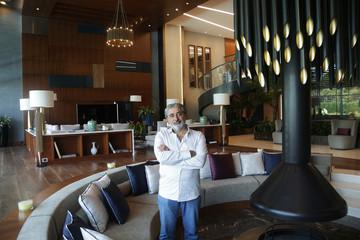 "Serdar Ali Abet, CEO of Karnak International Travel Agency, poses in a villa at Regnum Carya Hotel where the TV series ""Big House"" is filmed, in the Mediterranean resort city of Antalya"