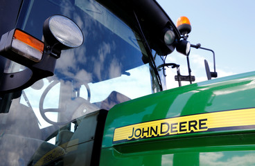 Logo of John Deere is seen on a tractor at the international agriculture exhibition in Minsk
