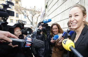Marion Marechal-Le Pen, French National Front political party member leaves the polling station during the first round of the regional elections in Carpentras
