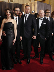 """Actress Dandoy, director Roskam, actor Schoenaerts, actor Perceval and another unidentified guest from the Belgian film """"Bullhead"""" arrive at the 84th Academy Awards in Hollywood"""