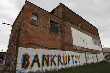"""File photo of the word """"Bankruptcy"""" is painted on the side of a building in Detroit Michigan"""