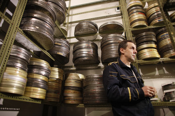 A worker stands by reels of film are seen in the Yugoslav Film Archive in Belgrade