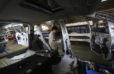 A man works on a vehicle at automaker Ford Vietnam's factory in Vietnam's northern Hai Duong province, outside Hanoi