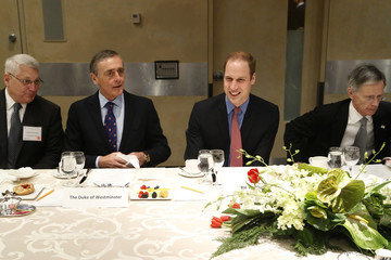 Britain's Prince William smiles as he sits down to lunch with Grosvenor, Manning, and Ham at the International Corruption Hunters Alliance conference at World Bank headquarters in Washington