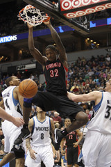 Raptors' Davis dunks the ball during the second half of their NBA basketball game against the Timberwolves in Minneapolis