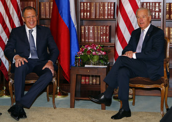 Russia's Foreign Minister Sergei Lavrov and US Vice-President Joe Biden meet at the 49th Conference on Security Policy in Munich