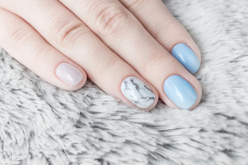 Professional nail manicure blue sky color and marble texture. Shaggy white background