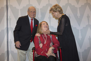 """Filmmaker and comedian Brooks and actress Leachman greet actress Garr at a 40th anniversary screening of """"Young Frankenstein"""" in Beverly Hills"""