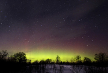The glow of the Aurora Borealis, or Northern Lights, is seen in the horizon in Kawartha Lakes