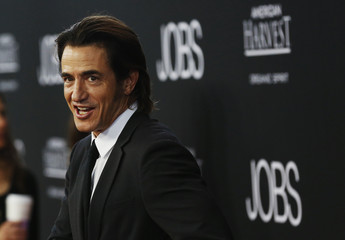 """Cast member Dermot Mulroney poses at the movie premiere of """"Jobs"""" in Los Angeles"""