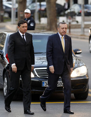 Slovenia's Prime Minister Borut Pahor and his Turkish counterpart Recep Tayyip Erdogan arrive a welcoming ceremony in Ankara