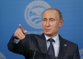 Russia's President Vladimir Putin gestures at a news conference after the Shanghai Cooperation Organization (SCO) summit in Ufa, Russia