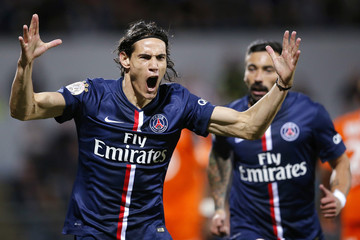 Paris St Germain's Cavani celebrates after scoring a goal against Lorient during the team's French Ligue 1 soccer match in Lorient