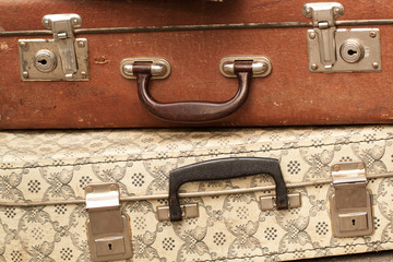 Two old suitcases with handles