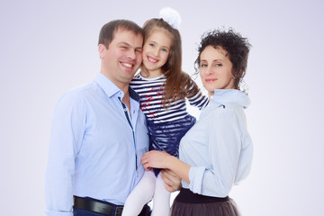 Happy parents with a small daughter.