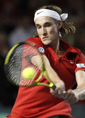 Belgium's Bemelmans plays a return to Spain's Nadal during their Davis Cup match in Charleroi