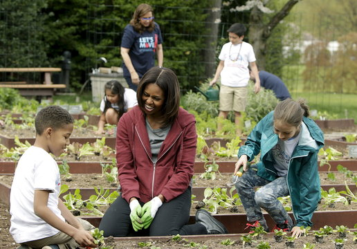 United States first Lady Obama plants vegetables with school children during spring planting of the White House vegetable garden in Washington