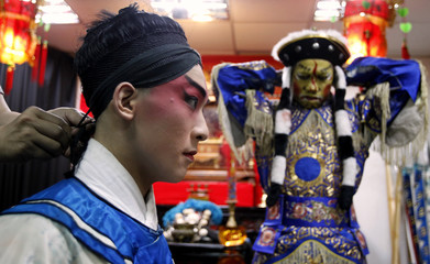 Contestants get ready backstage before the start of a Chinese opera competition held in the National Taiwan College of Performing Arts in Taipei