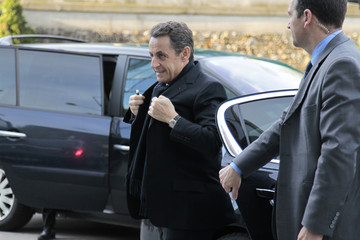 France's President and UMP candidate for the 2012 French presidential election, Nicolas Sarkozy, arrives before appearing on a prime time evening news broadcast at the TF1 Television studios in Boulogne-Billancourt, near Paris