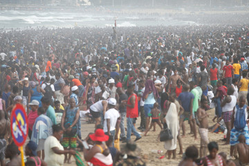 Revellers enjoy New Year's Day on a beach in Durban