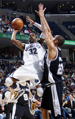 Grizzlies guard Mayo shoots while Spurs forward Duncan tries to defend during the first half of NBA basketball action in Memphis