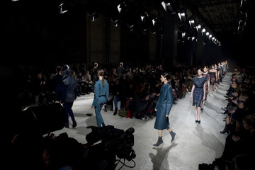 Models present creations by Portuguese designer Oliveira Baptista as part of his Fall-Winter 2013/2014 women's ready-to-wear fashion show during Paris fashion week