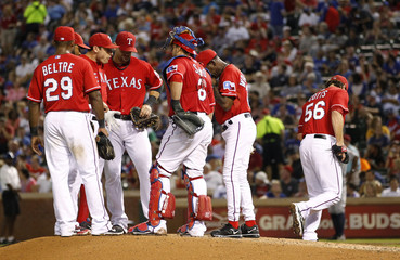 Texas Rangers' Cotts leaves the MLB American League baseball game against the Houston Astros in Arlington