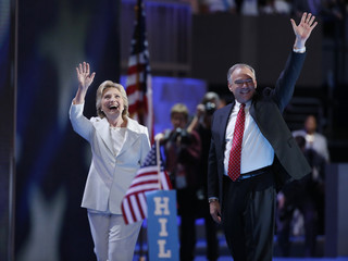 Democratic presidential nominee Hillary Clinton waves with her vice presidential running mate Senator Tim Kaine at the Democratic National Convention in Philadelphia, Pennsylvania