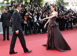 """Cast member Pitt and actress Jolie arrive for the screening of the film """"The Tree of Life"""" at the 64th Cannes Film Festival"""