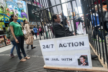 Chinese dissident Wang Juntao protests against the detention of political prisoner Wang Bingzhang, in New York