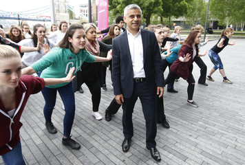 "London Mayor Sadiq Khan poses with dancers at a preview event of the ""Big Dance Pledge"", at City Hall in London"